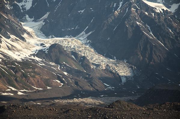 Cool glacier flowing into a debris covered glacier on the south side of Mt. McGinnis.