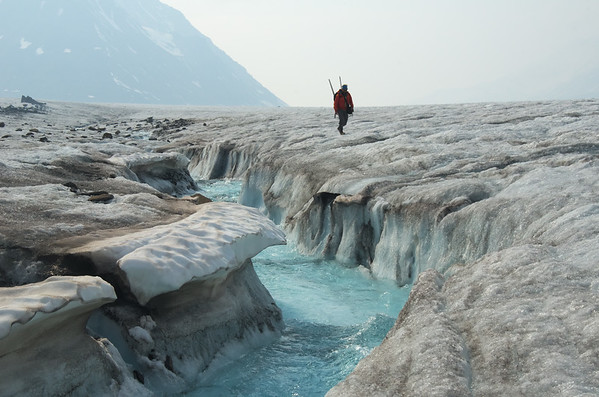 Hiking along a small supraglacial channel on a large tributary to the Black Rapids Glacier.