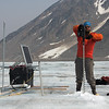 Andy drills a new hole for the antenna at the continuous (year-round) GPS station on the Loket tributary.