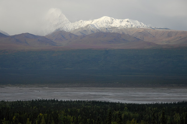 The Alaska Range over the Delta River on a really windy day. That sort of haze over the river is dust being kicked up.