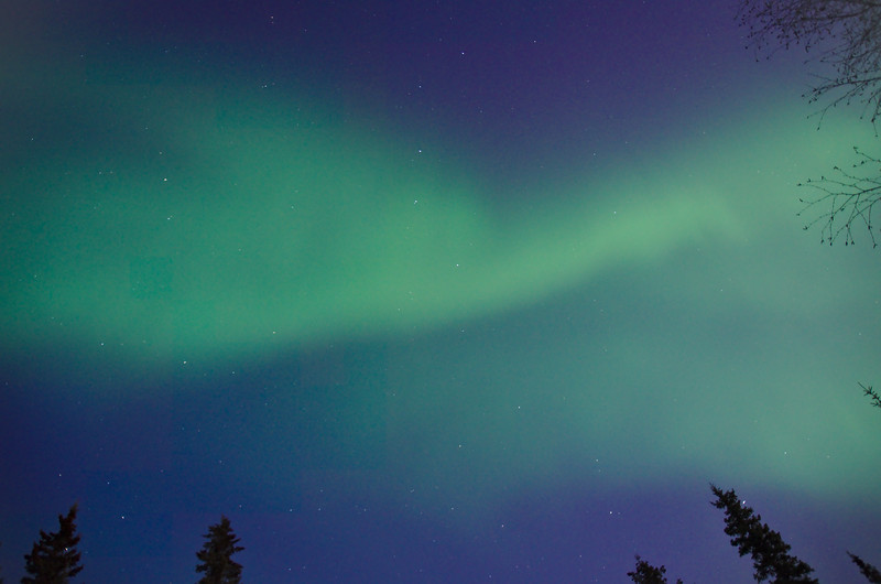 Aurora borealis in the still twilight sky.