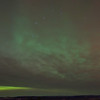 Big dipper and aurora behind the clouds