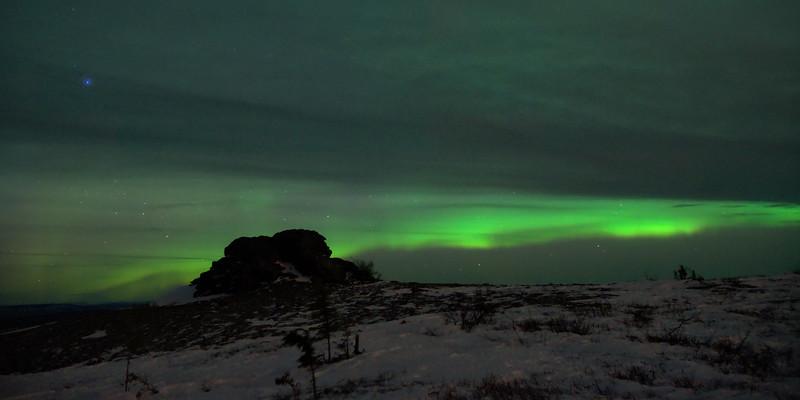 Clouds overtaking aurora