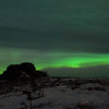 Clouds overtaking aurora