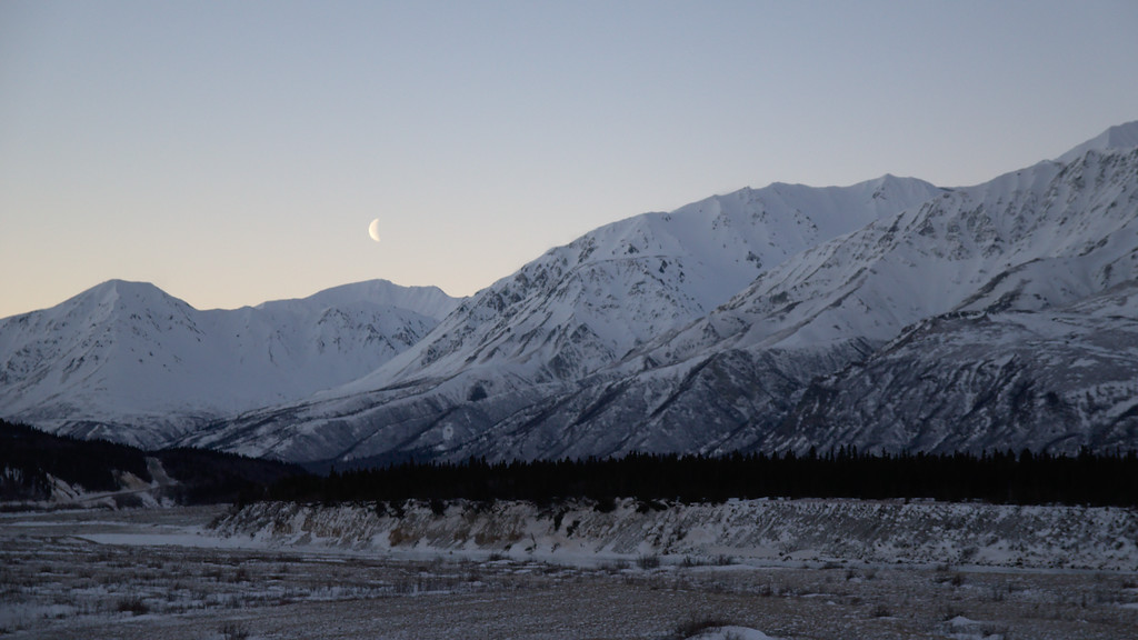 The moon about to set over the mountains to the south.