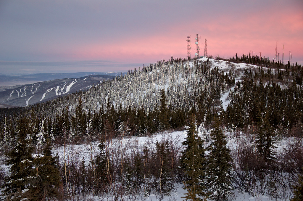 Looking at the towers on Ester Dome. Moose Mountain Ski area is in the distance. Nice soft pastel pink clouds.