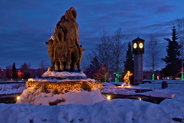 Lights and statue in twilight