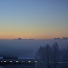 Mountains above the valley fog