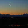 Crescent moon over the Alaska Range