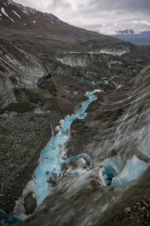 On the Canwell Glacier where the edge of the southern moraine meets exposed ice. Channels typically form next to moraines like this and since this is very near the toe of the glacier it's had a long time to form this deep channel.