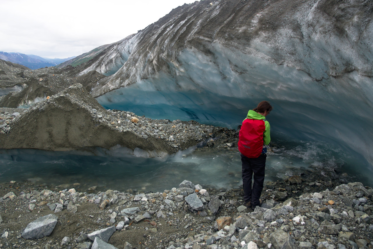 stream forming a small canyon and ice wall on the Canwell Glacier
