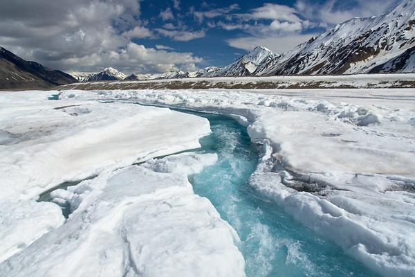 Blue supraglacial stream on the Black Rapids Glacier