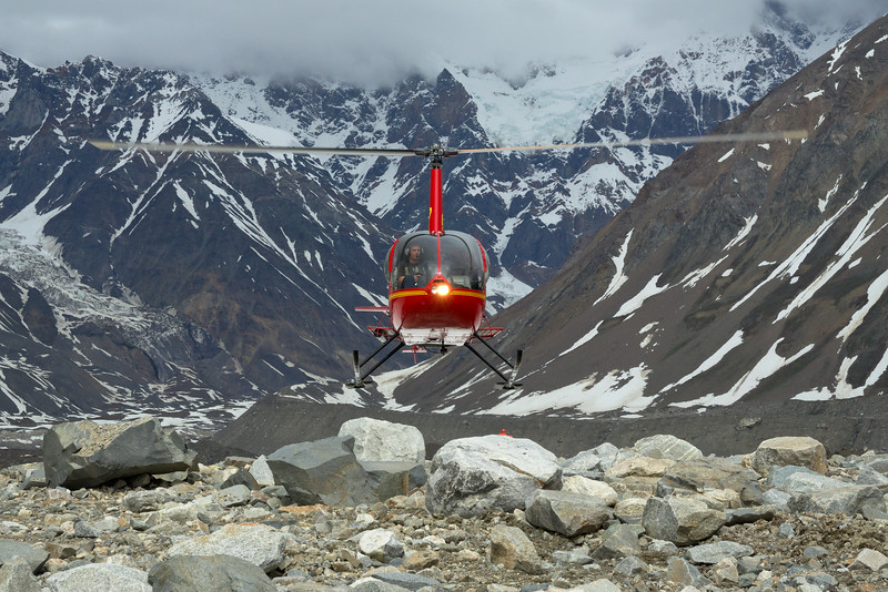 The R44 helicopter taking off on the moraine on the Black Rapids Glacier that will be our campsite for the next 15 days.