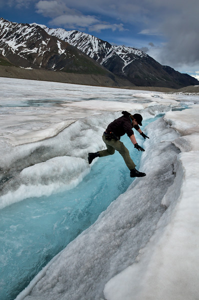 Andrew displays perfect form at one of the numerous channel crossings on the Black Rapids Glacier.
