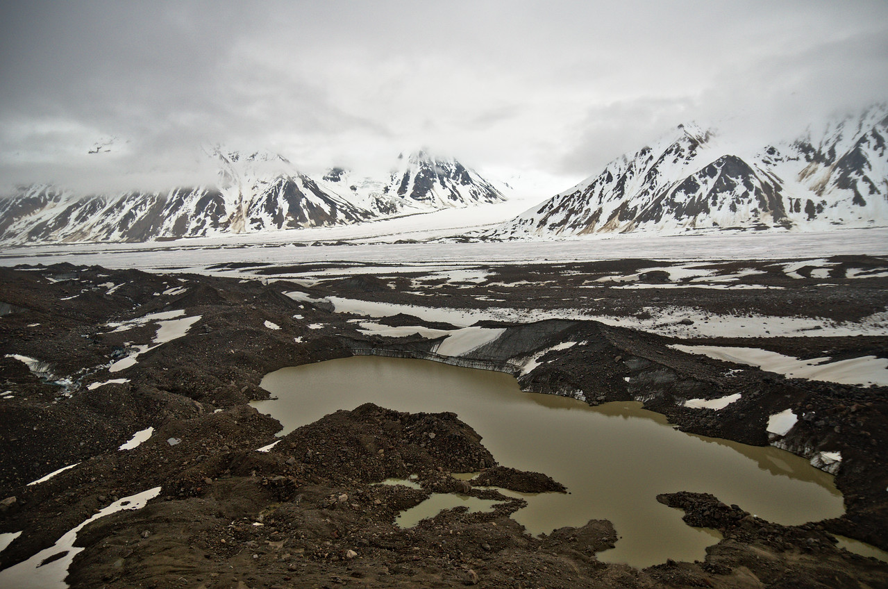 A lake that has formed on the surface of the Black Rapids Glacier