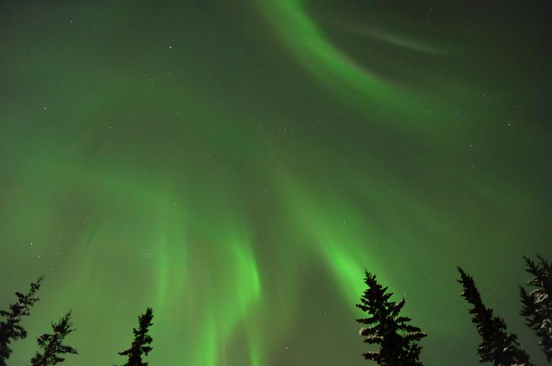 Diffuse aurora borealis filling the sky