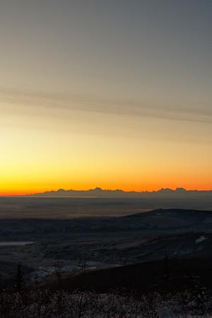Watching the sunrise from Ester Dome outside of Fairbanks, Alaska. Warm tones take over the Alaska Range as the sun nears the horizon.