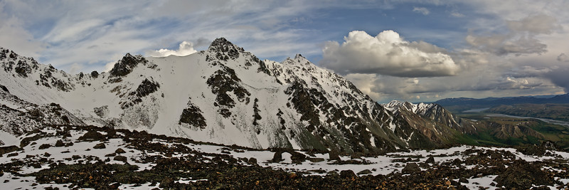 Snow-covered rocky mountains in the Alaska Range