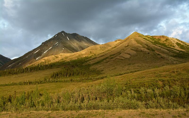 Golden light on the mountains in the Alaska Range