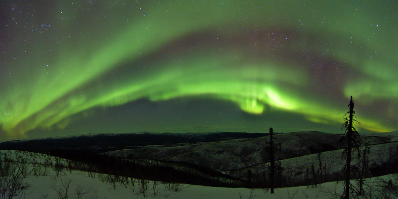 panoramic photo of the northern lights over the Chena River valley from the Granite Tors Trail
