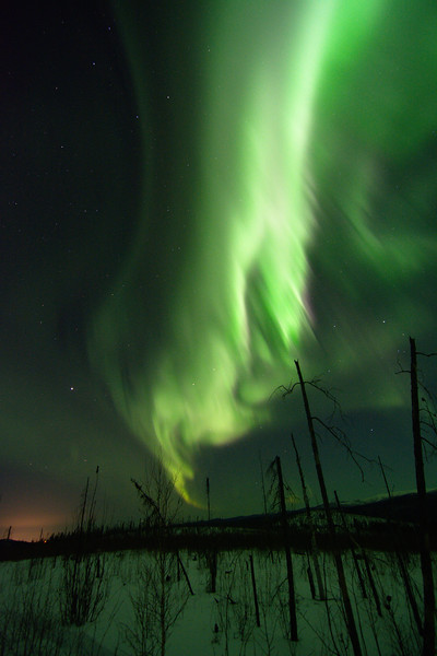 Bright green aurora borealis and Fairbanks city lights