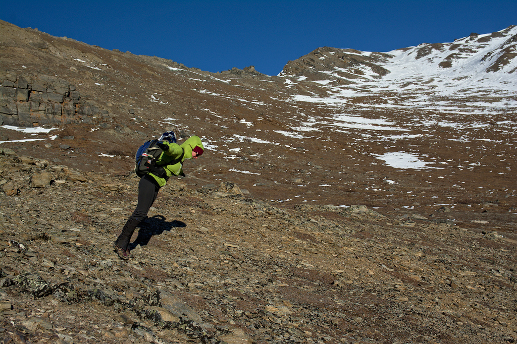 Hiker leaning against the wind on the Savage Alpine Trail