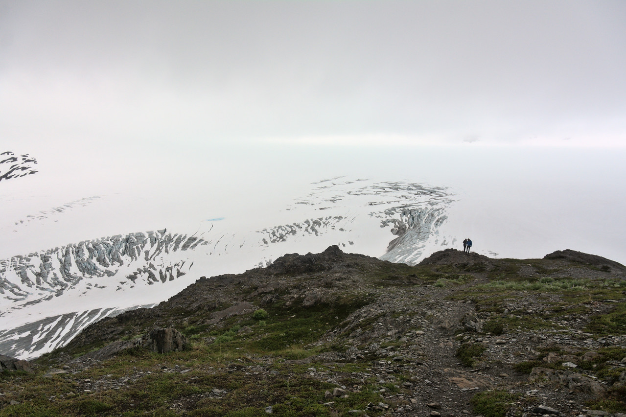 Hikers overlooking the Harding Icefield at the end of the Harding Icefield Trail