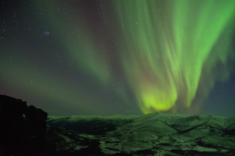 Photo of the aurora borealis, or northern lights and the Pleiades star cluster.