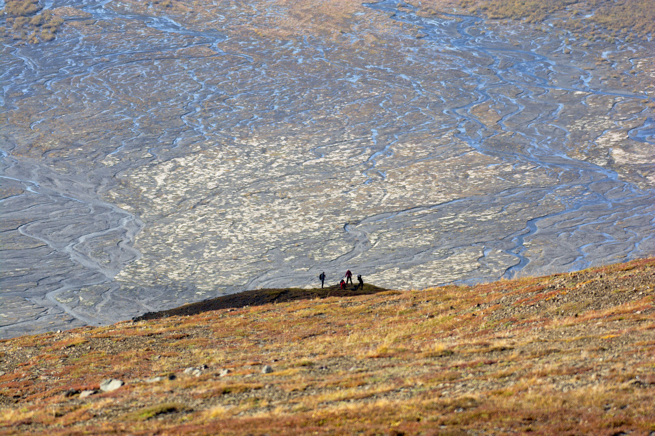Hikers taking photos on a bench above the Thorofare and McKinley Rivers. Taken from the Thoro Ridge.