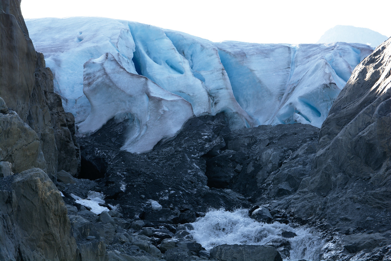 Water emerges from beneath the glacier at the top of the valley.