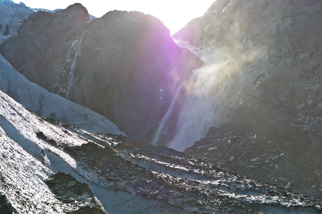 Huge waterfall viewed over the Worthington Glacier