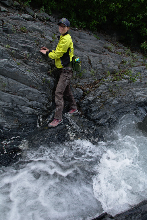 My wife showing her enthusiasm with a slick, rocky, steep stream crossing