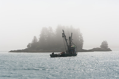 Fishing boat and foggy island