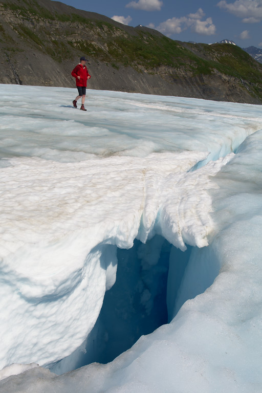 In spring and summer, snow persisting on the glacier is often covering crevasses or moulins like the one shown here. It's best to completely avoid snow if you are not roped up!