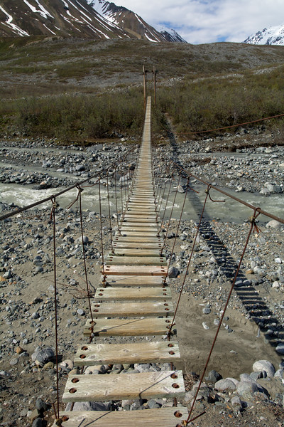 Long suspension bridge over College Creek in the Alaska Range along the hike to Gulkana Glacier