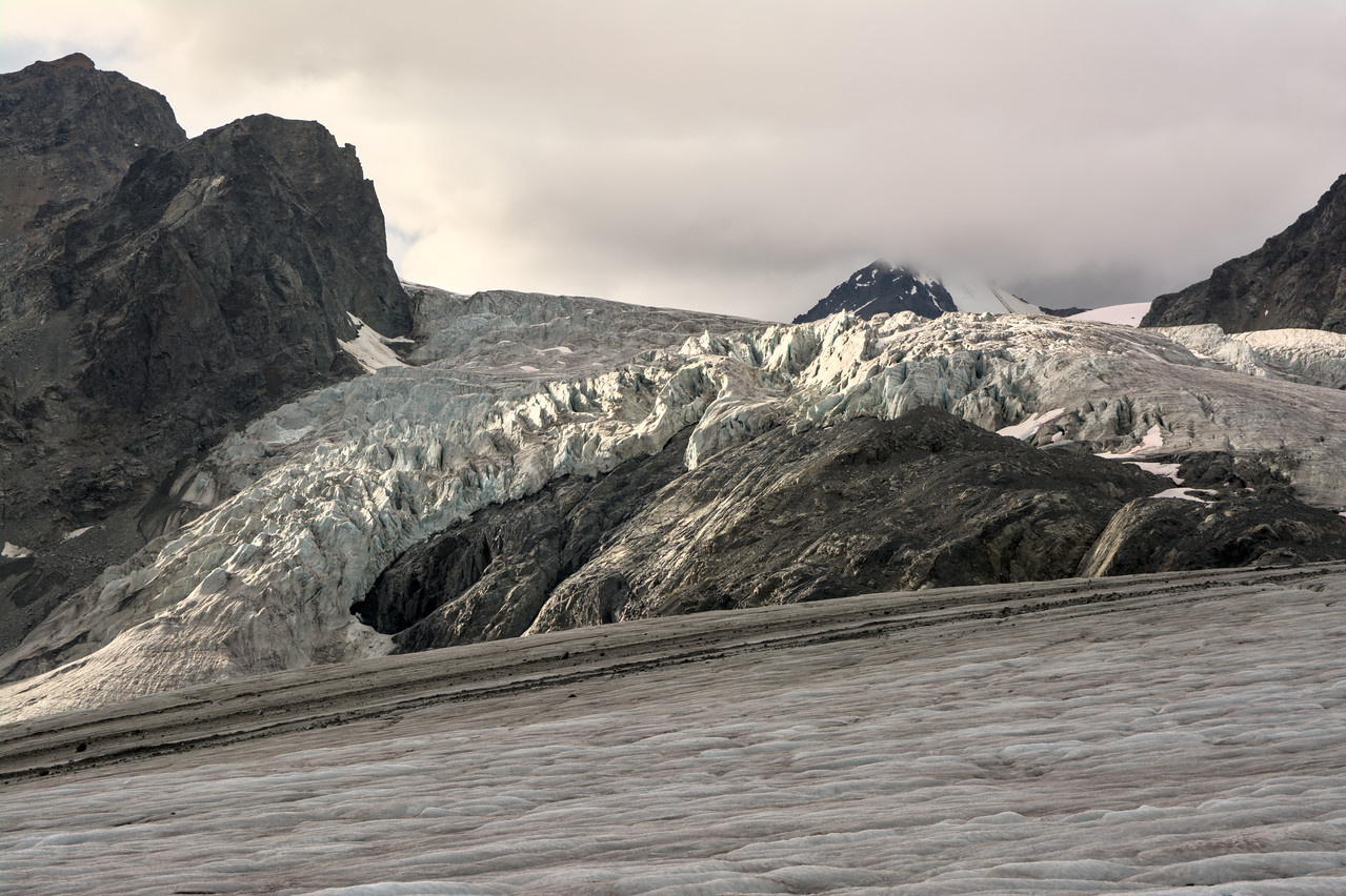 Light striking crevasses on the Gulkana Glacier before the rain
