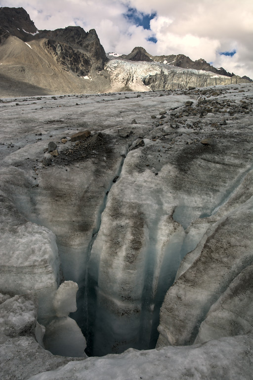 A large moulin and the Gabriel Icefall on the Gulkana Glacier