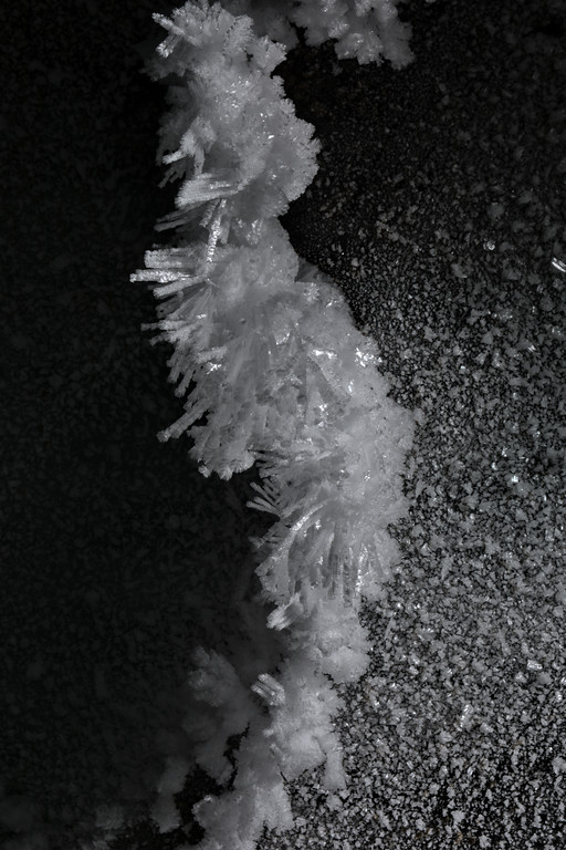 Ice crystals and hoarfrost on the ceiling of a glacier cave