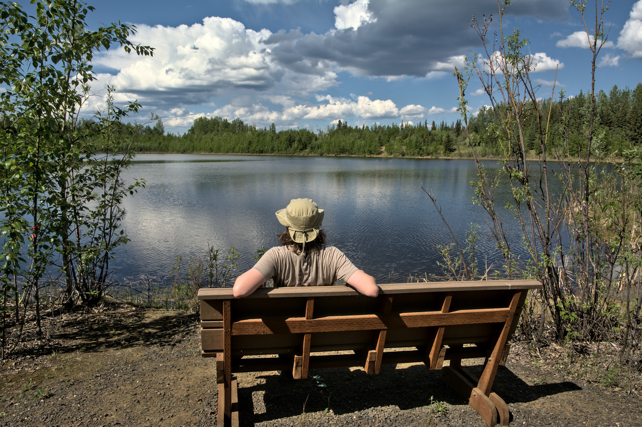 Relaxing on a bench at Wander Lake