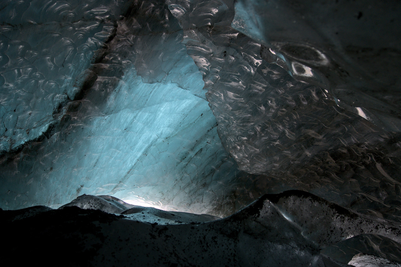 Smooth textures of a glacier icewall inside a cave