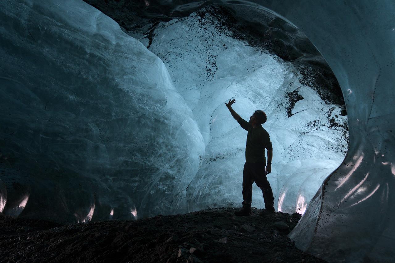 Person in a blue glacier cave