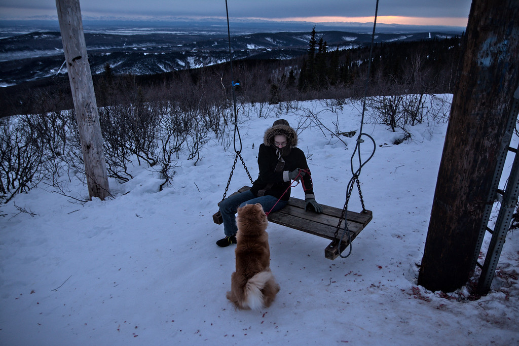A person on a bench with a dog