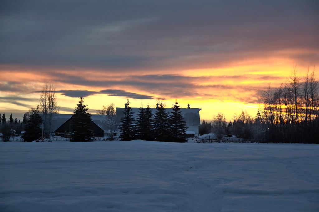 Sunset over the barn at Creamer's Field in Fairbanks