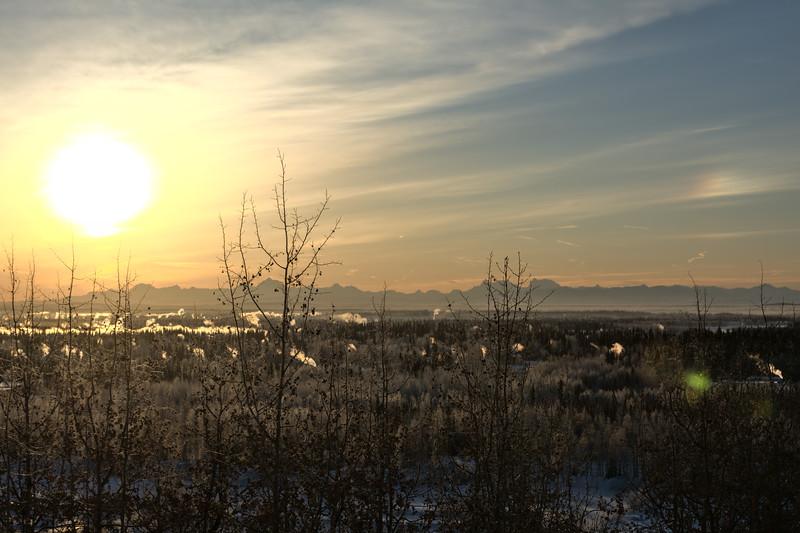Sun and sundog over the Alaska Range
