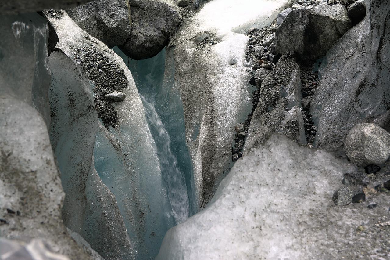 Water draining under a moulin near the Gabriel Icefall on the Gulkana Glacier