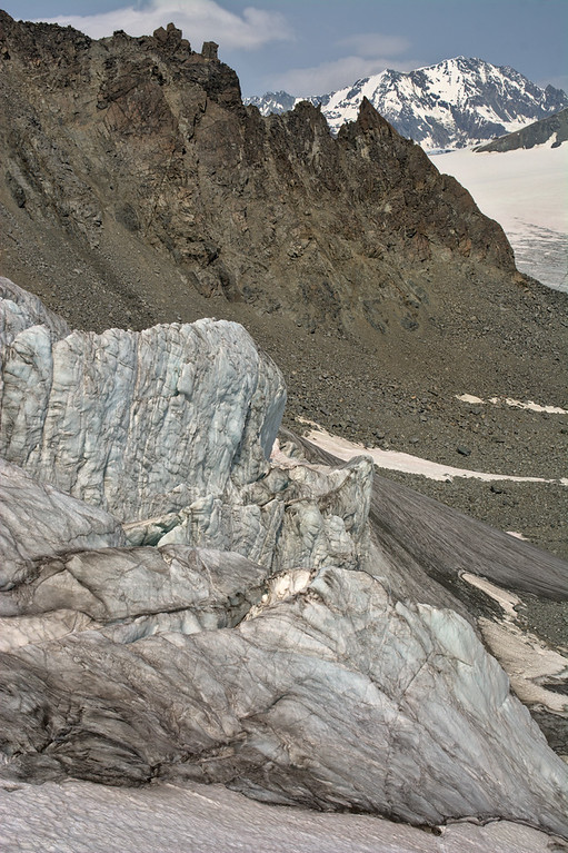 Passing a massive icefall under jagged mountains on the Gulkana Glacier