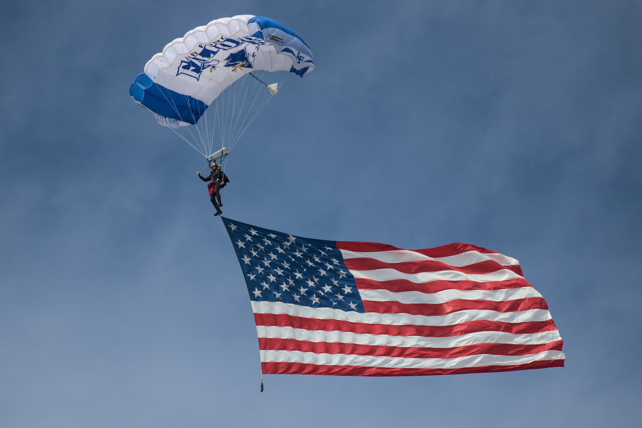 The United States Air Force Wings of Blue flying the America Flag for the National Anthem at the Arctic Lightning Air Show