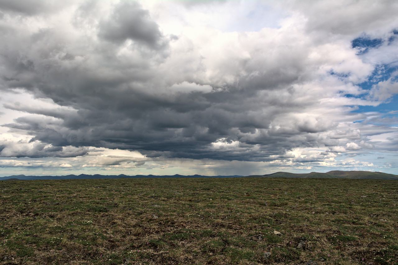Clouds and Rain over the open tundra along the Mastodon Dome Trail