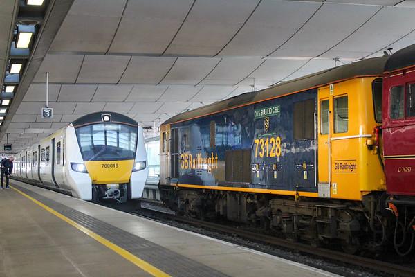 700018 arrives next to 73128 at London Blackfriars.