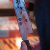 The reflection of an eye in the pattern engraved on a hand made Masakage knive